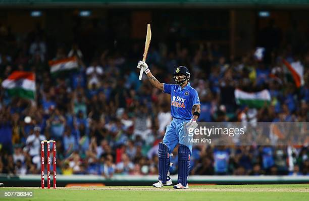 Virat Kohli of India celebrates and acknowledges the crowd after scoring a half century during the International Twenty20 match between Australia and...
