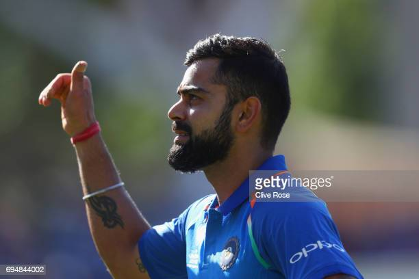 Virat Kohli of India celebrates as he leaves the field after the ICC Champions trophy cricket match between India and South Africa at The Oval in...