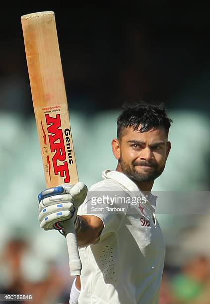 Virat Kohli of India celebrates as he reaches his century during day three of the First Test match between Australia and India at Adelaide Oval on...