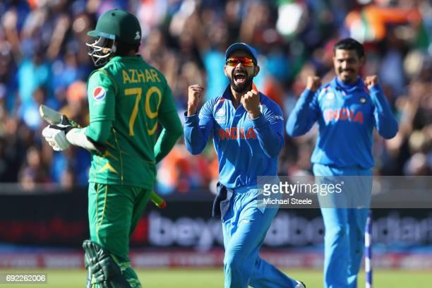 Virat Kohli of India celebrates as Ravindra Jadeja captures the wicket of Azhar Ali of Pakistan during the ICC Champions Trophy match between India...