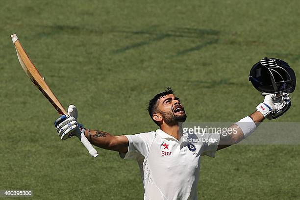 Virat Kohli of India celebrates his century during day five of the First Test match between Australia and India at Adelaide Oval on December 13 2014...