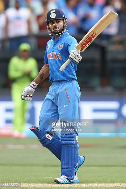 Virat Kohli of India celebrates his half century during the 2015 ICC Cricket World Cup match between India and Pakistan at Adelaide Oval on February...