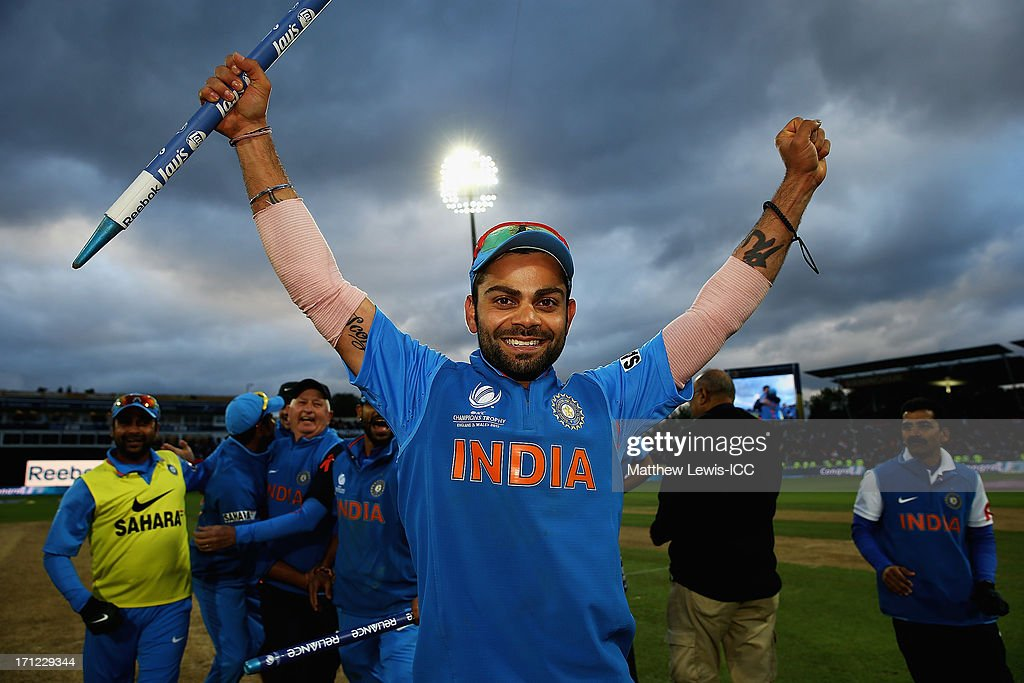 <a gi-track='captionPersonalityLinkClicked' href=/galleries/search?phrase=Virat+Kohli&family=editorial&specificpeople=4880246 ng-click='$event.stopPropagation()'>Virat Kohli</a> of India celebrates his teams win over England during the ICC Champions Trophy Final between England and India at Edgbaston on June 23, 2013 in Birmingham, England.
