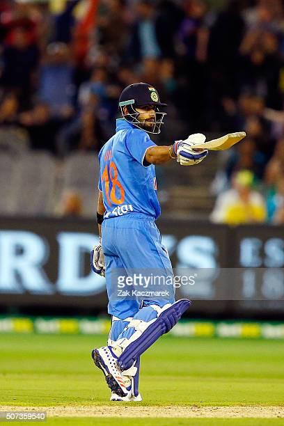 Virat Kohli of India celebrates reaching fifty runs during the International Twenty20 match between Australia and India at Melbourne Cricket Ground...
