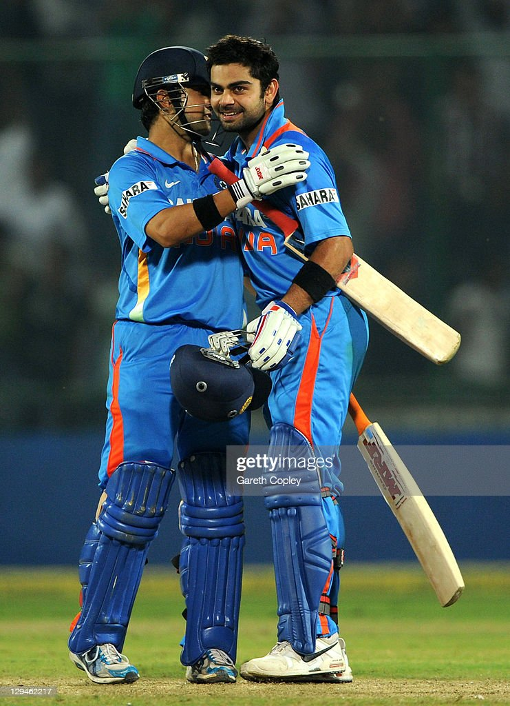 <a gi-track='captionPersonalityLinkClicked' href=/galleries/search?phrase=Virat+Kohli&family=editorial&specificpeople=4880246 ng-click='$event.stopPropagation()'>Virat Kohli</a> of India celebrates reaching his century with teammate <a gi-track='captionPersonalityLinkClicked' href=/galleries/search?phrase=Gautam+Gambhir&family=editorial&specificpeople=707703 ng-click='$event.stopPropagation()'>Gautam Gambhir</a> during the 2nd One Day International between India and England at Feroz Shah Kotla Stadium on October 17, 2011 in Delhi, India.