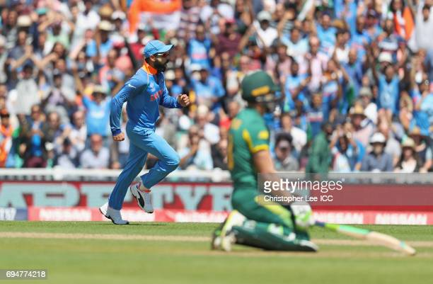 Virat Kohli of India celebrates running out David Miller of South Africa during the ICC Champions Trophy Group B match between India and South Africa...