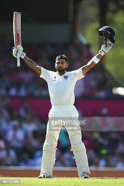 Virat Kohli of India celebrates scoring a century and faces Australian fans during day three of the Fourth Test match between Australia and India at...