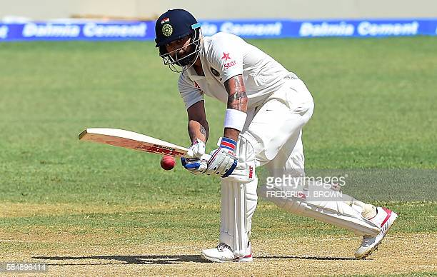 Virat Kohli of India connects for a run off a delivery from West Indies bowler Roston Chase on day 2 of the 2nd Test between India and the West...