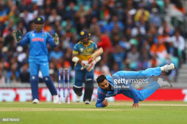 Virat Kohli of India dives to catch off his bowling during the ICC Champions trophy cricket match between India and Sri Lanka at The Oval in London...