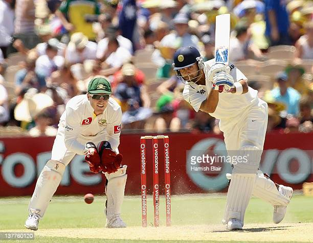 Virat Kohli of India drives with Brad Haddin of Australia looking on during day three of the Fourth Test Match between Australia and India at...