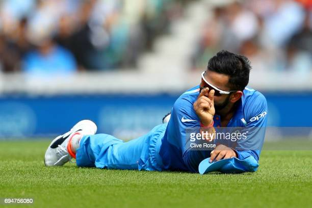 Virat Kohli of India gestures after narrowly failing to run out Quinton de Kock of South Africa during the ICC Champions trophy cricket match between...