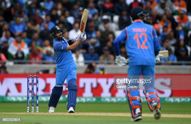 Virat Kohli of India hits out for six runs during the ICC Champions Trophy match between India and Pakistan at Edgbaston on June 4 2017 in Birmingham...
