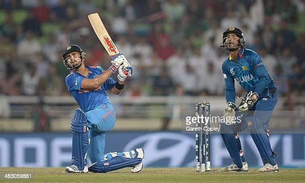 Virat Kohli of India hits out for six runs during the ICC World Twenty20 Bangladesh 2014 Final between India and Sri Lanka at ShereBangla Mirpur...