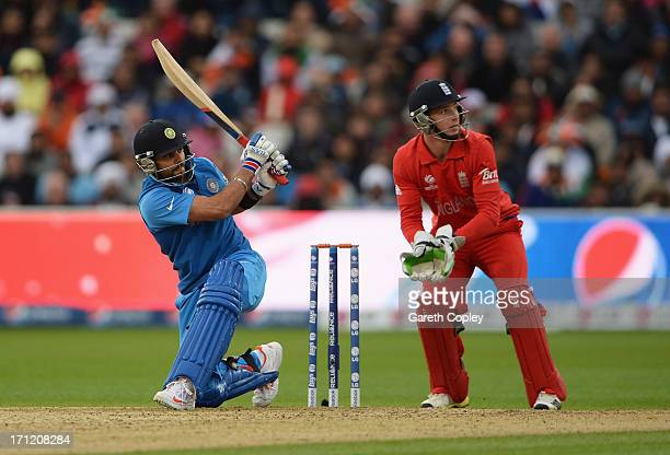 Virat Kohli of India hits out watched by Jos Buttler of England during the ICC Champions Trophy Final between England and India at Edgbaston on June...
