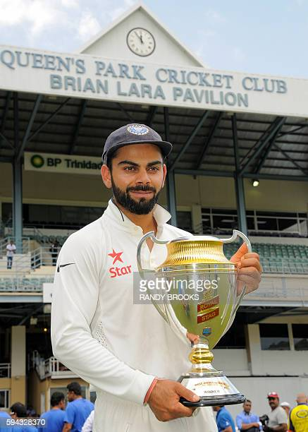 Virat Kohli of India holds the series trophy August 22 2016 after play was abandoned on day 5 of the 4th and final Test between West Indies and India...