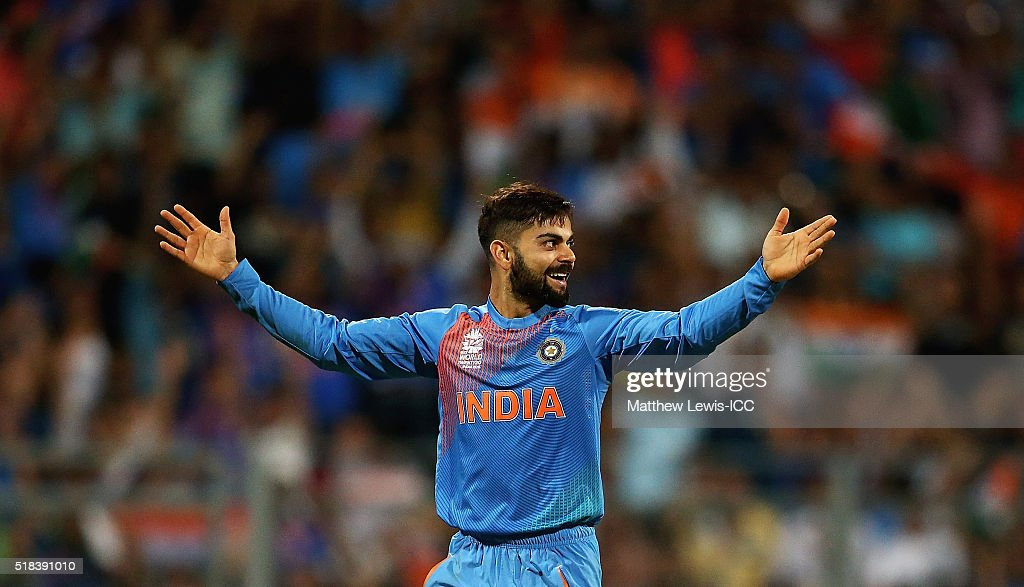 <a gi-track='captionPersonalityLinkClicked' href=/galleries/search?phrase=Virat+Kohli&family=editorial&specificpeople=4880246 ng-click='$event.stopPropagation()'>Virat Kohli</a> of India is celebrates the wicket of Johnson Charles of the West Indies, after he was caught by Rohit Sharma of India during the ICC World Twenty20 India 2016 Semi-Final match between West Indies and India at the Wankhede Stadium on March 31, 2016 in Mumbai, India.