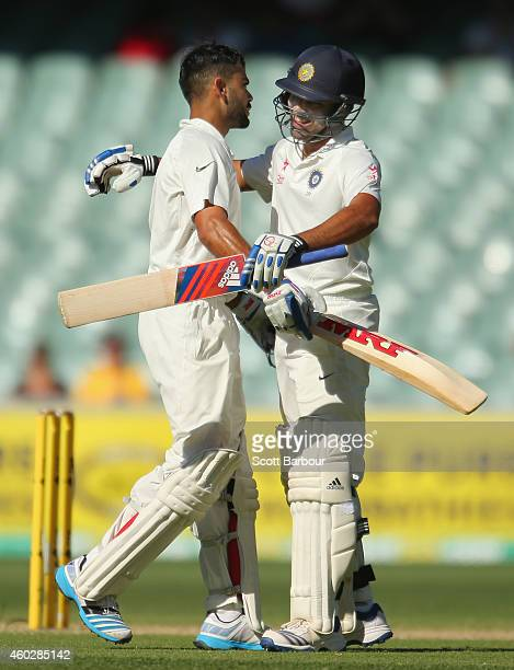 Virat Kohli of India is congratulated by Rohit Sharma as he reaches his century during day three of the First Test match between Australia and India...