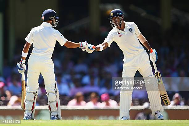 Virat Kohli of India is congratulated by team mate Lokesh Rahul of India after scoring fifty runs during day three of the Fourth Test match between...