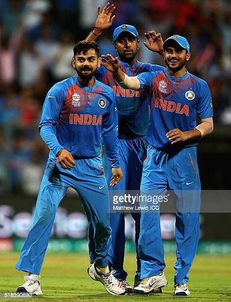Virat Kohli of India is congratulated by team mates on the wicket of Johnson Charles of the West Indies after he was caught by Rohit Sharma of India...