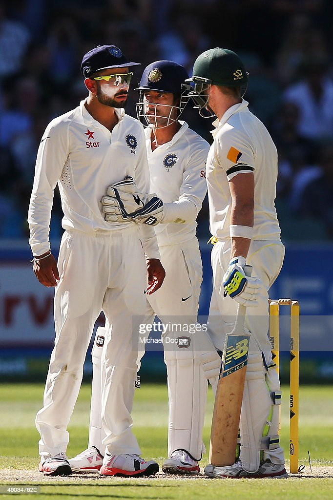 <a gi-track='captionPersonalityLinkClicked' href=/galleries/search?phrase=Virat+Kohli&family=editorial&specificpeople=4880246 ng-click='$event.stopPropagation()'>Virat Kohli</a> of India is held back by keeper <a gi-track='captionPersonalityLinkClicked' href=/galleries/search?phrase=Wriddhiman+Saha&family=editorial&specificpeople=5834850 ng-click='$event.stopPropagation()'>Wriddhiman Saha</a> as he has words with Steve Smith of Australia after he padded away another ball from Rohit Sharma during day four of the First Test match between Australia and India at Adelaide Oval on December 12, 2014 in Adelaide, Australia.