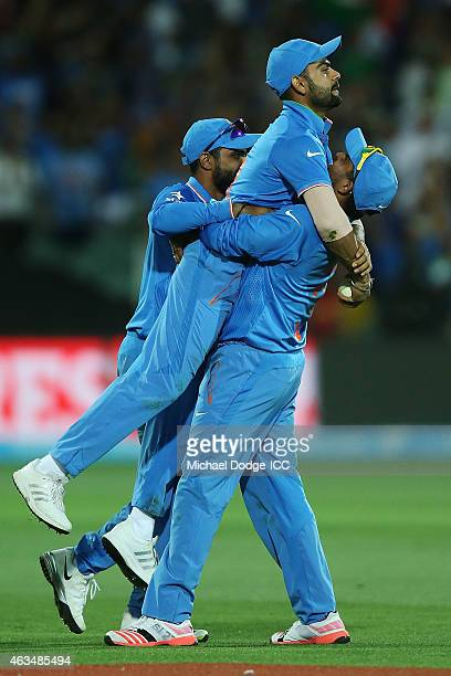 Virat Kohli of India is hoisted up after taking a catch during the 2015 ICC Cricket World Cup match between India and Pakistan at Adelaide Oval on...