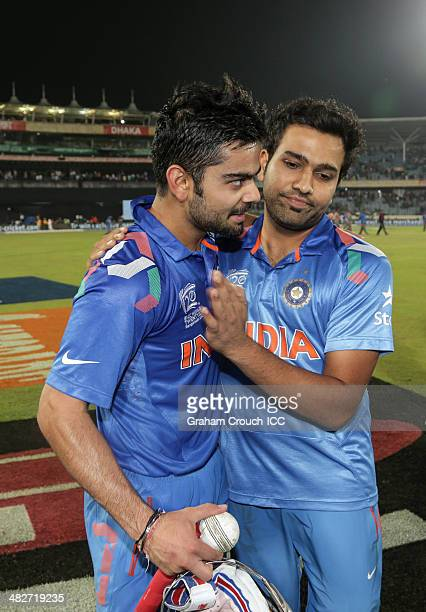 Virat Kohli of India is hugged by Rohit Sharma after securing victory for India during the India v South Africa semi final match at ShereBangla...