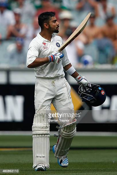 Virat Kohli of India kisses hi bat after scoring 100 runs during day three of the Third Test match between Australia and India at Melbourne Cricket...