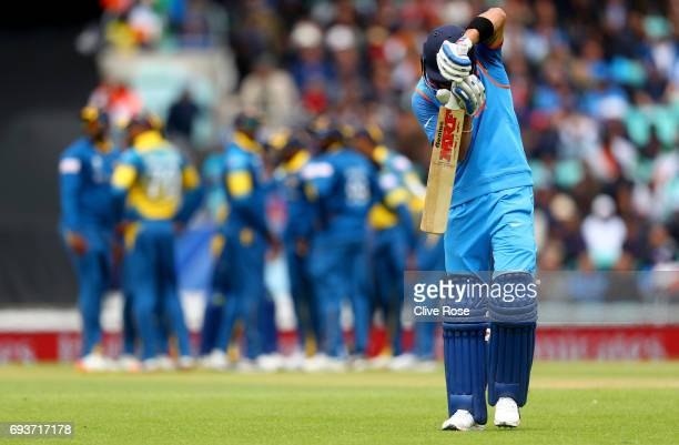 Virat Kohli of India leaves the fied after being dismissed during the ICC Champions trophy cricket match between India and Sri Lanka at The Oval in...