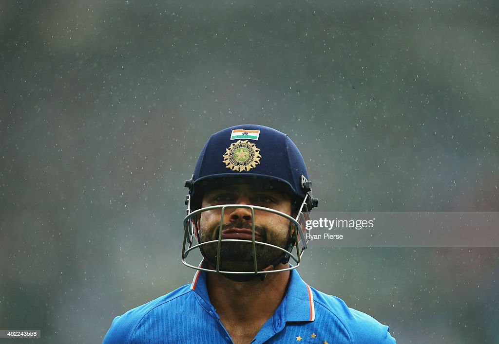<a gi-track='captionPersonalityLinkClicked' href=/galleries/search?phrase=Virat+Kohli&family=editorial&specificpeople=4880246 ng-click='$event.stopPropagation()'>Virat Kohli</a> of India leaves the ground after rain stopped play during the One Day International match between Australia and India at Sydney Cricket Ground on January 26, 2015 in Sydney, Australia.