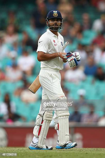 Virat Kohli of India looks dejected after being dismissed by Mitchell Starc of Australia during day five of the Fourth Test match between Australia...