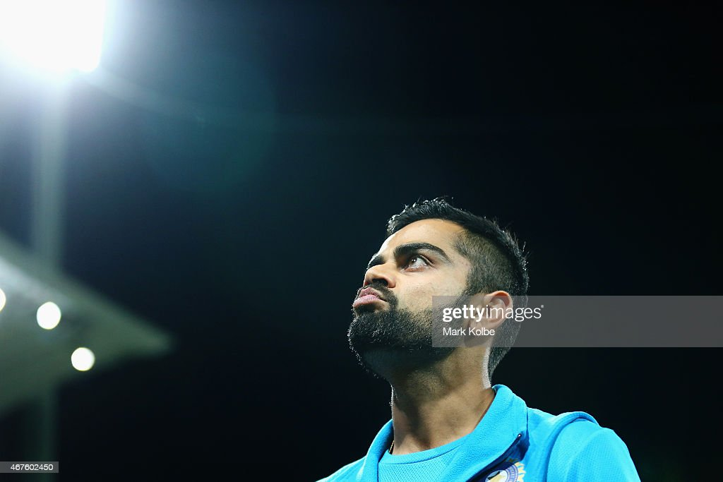 <a gi-track='captionPersonalityLinkClicked' href=/galleries/search?phrase=Virat+Kohli&family=editorial&specificpeople=4880246 ng-click='$event.stopPropagation()'>Virat Kohli</a> of India looks dejected as he leaves the field after defeat during the 2015 Cricket World Cup Semi Final match between Australia and India at Sydney Cricket Ground on March 26, 2015 in Sydney, Australia.