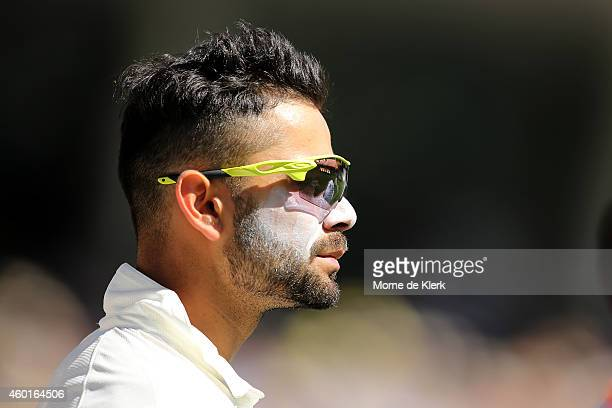 Virat Kohli of India looks on during day one of the First Test match between Australia and India at Adelaide Oval on December 9 2014 in Adelaide...