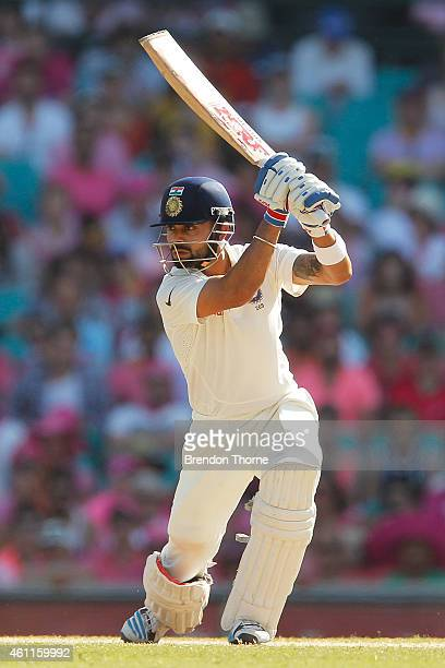 Virat Kohli of India plays a cover drive during day three of the Fourth Test match between Australia and India at Sydney Cricket Ground on January 8...