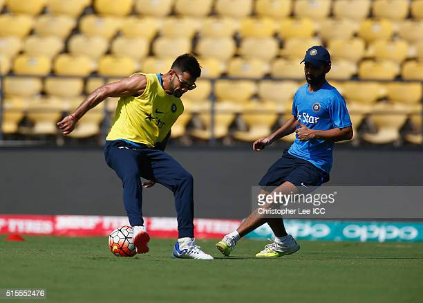 Virat Kohli of India plays a game of football as the team warm up during the India Training and Press Conference at the Vidarbha Cricket Association...