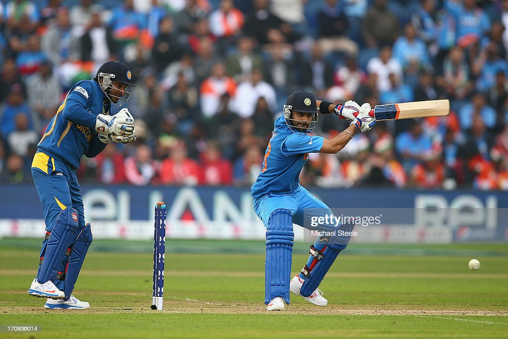 <a gi-track='captionPersonalityLinkClicked' href=/galleries/search?phrase=Virat+Kohli&family=editorial&specificpeople=4880246 ng-click='$event.stopPropagation()'>Virat Kohli</a> (R) of India plays to the offside as wicketkeeper <a gi-track='captionPersonalityLinkClicked' href=/galleries/search?phrase=Kumar+Sangakkara&family=editorial&specificpeople=206804 ng-click='$event.stopPropagation()'>Kumar Sangakkara</a> (L) of Sri Lanka looks on during the ICC Champions Trophy Semi-Final match between India and Sri Lanka at the SWALEC Stadium on June 20, 2013 in Cardiff, Wales.