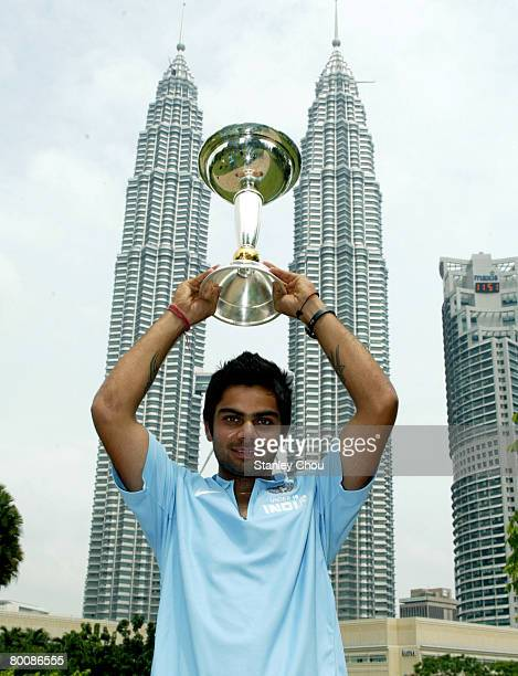 Virat Kohli of India poses with the ICC U19 Cricket World Cup at the Kuala Lumpur Twin Towers on March 3 2008 in Kuala Lumpur Malaysia