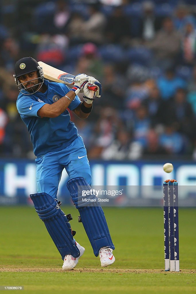 <a gi-track='captionPersonalityLinkClicked' href=/galleries/search?phrase=Virat+Kohli&family=editorial&specificpeople=4880246 ng-click='$event.stopPropagation()'>Virat Kohli</a> of India pplays a delivery square during the ICC Champions Trophy Semi-Final match between India and Sri Lanka at the SWALEC Stadium on June 20, 2013 in Cardiff, Wales.