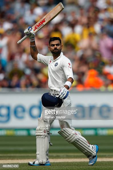 Virat Kohli of India raises his bat after scoring 100 runs during day three of the Third Test match between Australia and India at Melbourne Cricket...