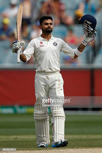 Virat Kohli of India raises his bat after scoring 150 runs during day three of the Third Test match between Australia and India at Melbourne Cricket...