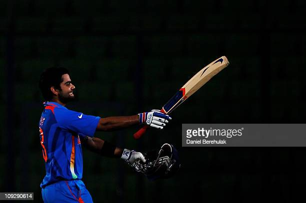 Virat Kohli of India raises his bat on reaching his century during the opening game of the ICC Cricket World Cup between Bangladesh and India at the...