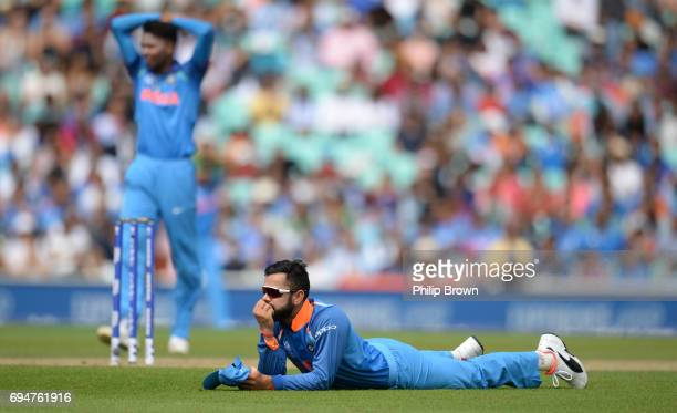 Virat Kohli of India reacts after missing a run out chance during the ICC Champions Trophy match between India and South Africa at the Kia Oval...