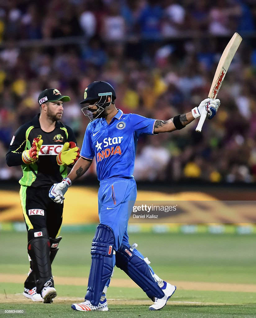 <a gi-track='captionPersonalityLinkClicked' href=/galleries/search?phrase=Virat+Kohli&family=editorial&specificpeople=4880246 ng-click='$event.stopPropagation()'>Virat Kohli</a> of India reacts after reaching his half century during game one of the Twenty20 International match between Australia and India at Adelaide Oval on January 26, 2016 in Adelaide, Australia.