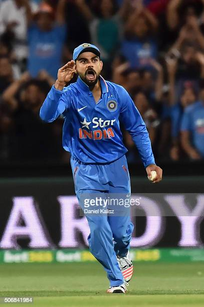 Virat Kohli of India reacts after taking a catch to dismiss Steven Smith of Australia during game one of the Twenty20 International match between...
