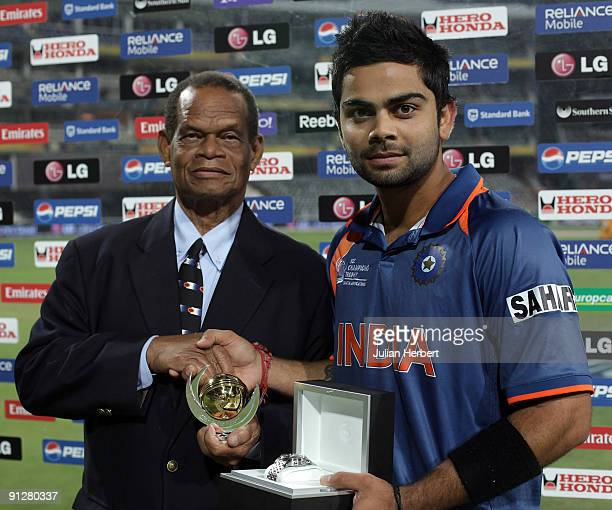 Virat Kohli of India recieves the man of the match award from The Hon Dr Julian Hunt of The WICB after The ICC Champions Trophy Group A Match between...