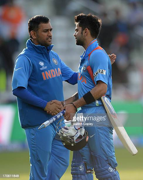 Virat Kohli of India shakes hands with captain MS Dhoni after winning the ICC Champions Trophy match between India and Pakiatan at Edgbaston on June...