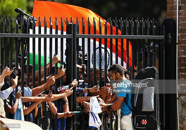 Virat Kohli of India signs autographs for fans during the India nets session at Sydney Cricket Ground on March 25 2015 in Sydney Australia
