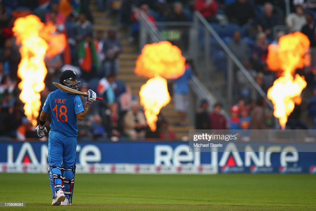 <a gi-track='captionPersonalityLinkClicked' href=/galleries/search?phrase=Virat+Kohli&family=editorial&specificpeople=4880246 ng-click='$event.stopPropagation()'>Virat Kohli</a> of India stands alone as the pirotechnics explode during the ICC Champions Trophy Semi-Final match between India and Sri Lanka at the SWALEC Stadium on June 20, 2013 in Cardiff, Wales.