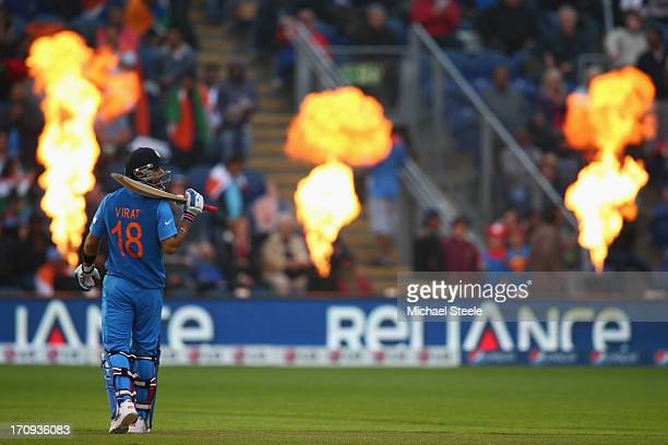 Virat Kohli of India stands alone as the pirotechnics explode during the ICC Champions Trophy SemiFinal match between India and Sri Lanka at the...