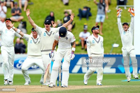 Virat Kohli of India stands his ground as Peter Fulton Corey Anderson James Neesham Brendon McCullum and BJ Watling of New Zealand appeal...