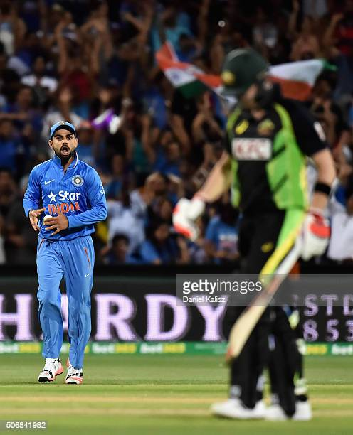Virat Kohli of India takes a catch to dismiss Steven Smith of Australia during game one of the Twenty20 International match between Australia and...
